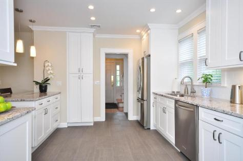 light and white contemporary kitchen quality cabinets and symmetry