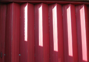 red metal folding door