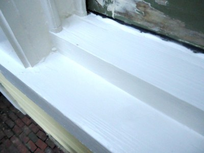 repaired wood window sill painted