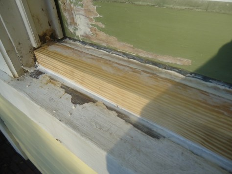 wood window patched in wood WoodEpox filler
