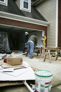 Men Working on a Home Garage and Driveway