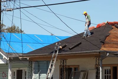 Avoiding Home Improvement Scams :: Man Working on Roofs in Louisiana