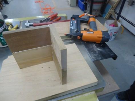 brad nailing the box