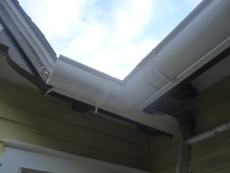 half round gutter tied back with piano wire
