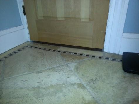 space at bottom of bath door