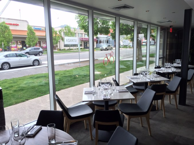 Large windows allow diners full street views. Photo by Isaac Riddle.
