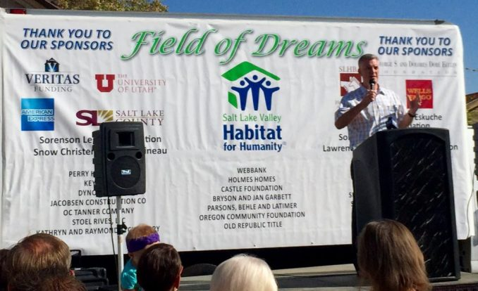 Former Salt Lake County Mayor and Vice President of the Board of Directors of the Salt Lake Valley Habitat for Humanity, Peter Corroon speaks to the crowd during the groundbreaking for the Field of Dreams Eco-Community in Kearns. Photo by Isaac Riddle.