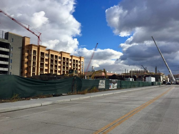 Construction is still underway on the south wing of the 4th West Apartments (pictured left) and the East and West Village buildings (pictured right). Photo by Isaac Riddle.