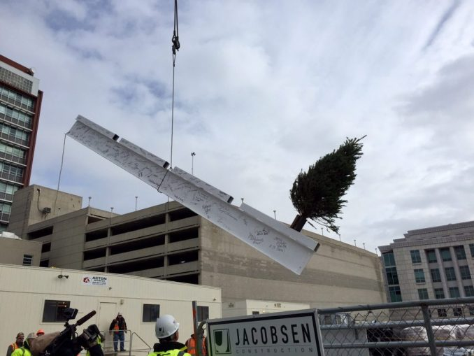 Construction crews lift the final steel beam into place.  Photo by Isaac Riddle.