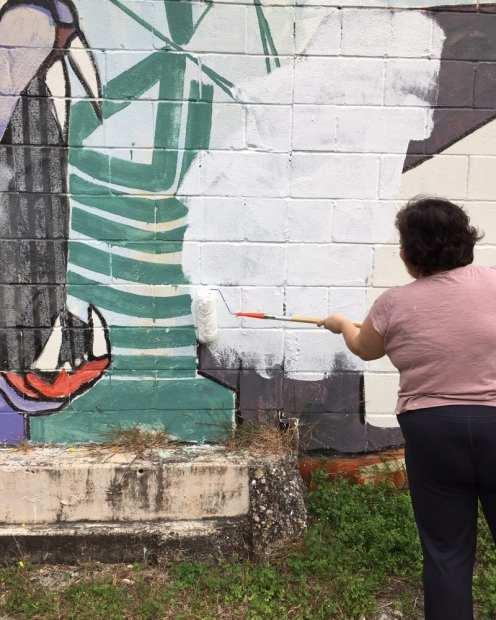 Laura Burlton, priming the wall by Judy Sherrod