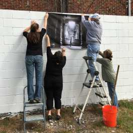 "Marti Corn, Laura Burlton, Aubrey Guthrie and Sara Silks pat the first image, Jane Alt's ""The Prayer"" by Judy Sherrod"
