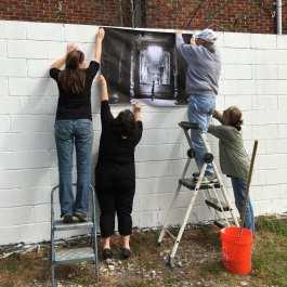 "Marti Corn, Laura Burlton, Aubrey Guthrie and Sara Silks pat the first image, Jane Alt's ""The Prayer"" by Judy Sherrod"