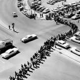 Like a giant serpent, the line of black college demonstrators wends its way around the courthouse area, coming out from Jefferson Street and James Robertson Boulevard April 19, 1960. The blacks, on the day of the Z. Alexander Looby bombing, marching three abreast stretched 10 blocks. The Tennessean