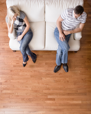 Young Couple Sitting on Love Seat