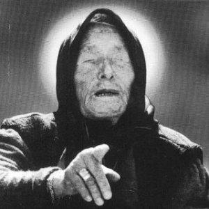 """БАБА ВАНГА - Вангелия Пандева Гущерова (Ванга, Петричката врачка, Баба Ванга или Леля Ванга) (31 Януари 1911г.-11 Август 1996г.) е наречена българска пророчица, заради способноста й да вижда съдбата на всеки човек, който я посещава.На 12-годишна възраст загубва зрението си в следствие на внезапна буря, при която Ванга е грабната от силния вятър и по-късно, след дълго търсене бива открита затрупана с камъни и пръст в една нива. Постепенно започва да предсказава и да помага на много хора. През последните години от живота си тя инвестира построяването на параклиса """"Св. Петка Българска"""" в местността Рупите, Петричко. Поради неканоничност параклисът не е осветен от БПЦ, затова за него се говори просто като за """"храм"""", без да се уточнява на коя религия. Баба Ванга умира на 11 август 1996 г."""