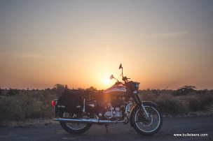 Classic 500 with chrome tank at sunrise, with sun shining on the chrome