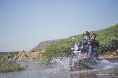 Bulleteer Dinesh Gupta crossing a shallow water crossing