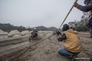 A rider splashing through mud near the end of his lap in the time trials at rider mania 2015