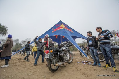 Team mates cheer a rider as he returns from his stint at the time trials during the Rider Mania 2015