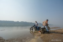 A Royal Enfield Desert Storm and a hero impulse stuck in wet sand at Chambal