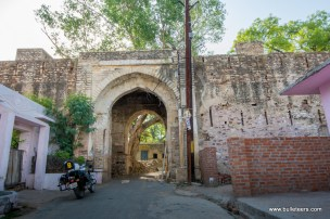 a royal enfield classic 500 at one of the gates of gohad fort