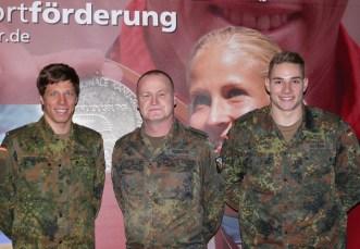 Triathlet Justus Nieschlag, Stefan Kainath und Leichtathlet Johannes Vetter.