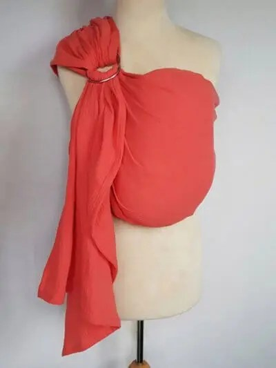 Coral ringsling on a mannequin