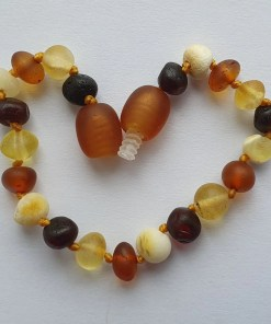 Raw mixed amber anklet arranged into a heart