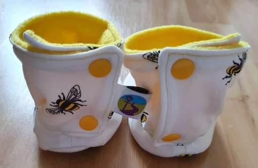 Rear of White boots with bee design