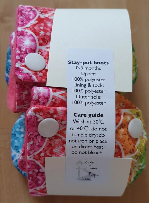Packaging of Rainbow stay-put boots with scales design