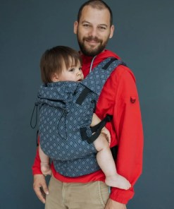 Man wearing baby in Neko Switch Lycia Onyx