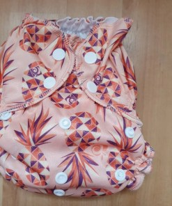 Pinky-peach AppleCheeks nappy with geo pineapple print