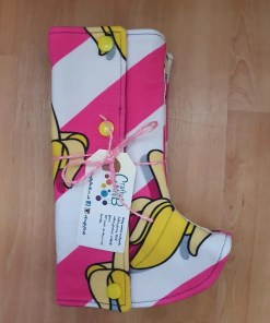 Pink and white diagonal stripes with cartoon banana pattern