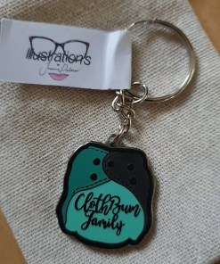 Black metal keyring with green toned nappy image, with the words Cloth Bum Family