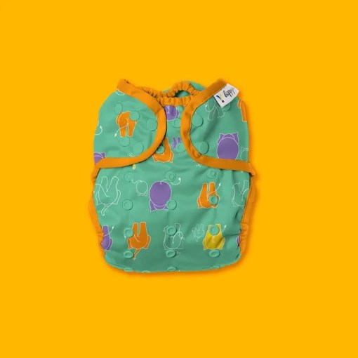 Green nappy with orange, yellow and purple elephants
