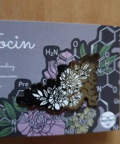 Oxytocin symbol pin badge with white flowers