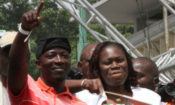 Charles Ble Goude stands with Simone Gbagbo, wife of Laurent Gbagbo, during rally in Abidjan