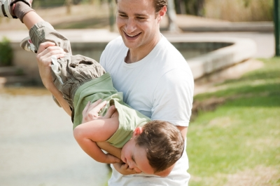 father and son playing, positive parenting