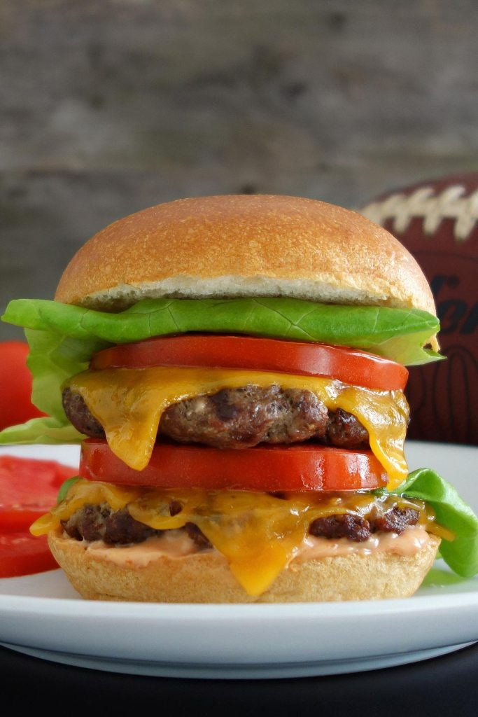 The outstanding double California burger, topped off with fresh lettuce and tomato slices. Perfect for grilling!
