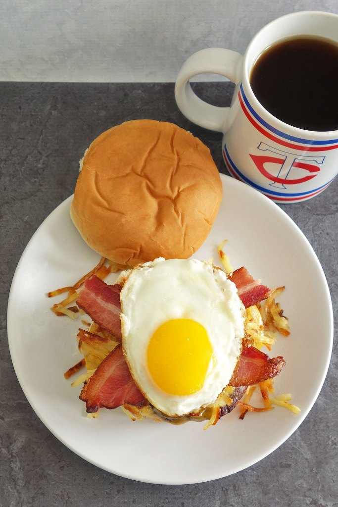 hangover burger topped off with hash browns and a sunny side up egg