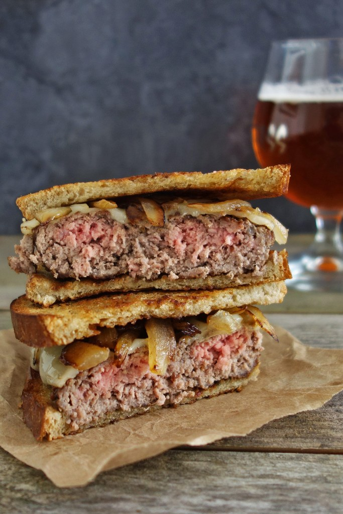 The patty melt is a traditional cheeseburger with caramelized onions on sliced rye bread that's been enjoyed since the 40's. Enjoy this burger recipe!
