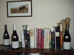 Arlaud Cuverie passageway bookshelf atop your reporters laptop bureau. Tempting bottles. Pic on wall of Bertille Arlaud with Nougat (the horse).