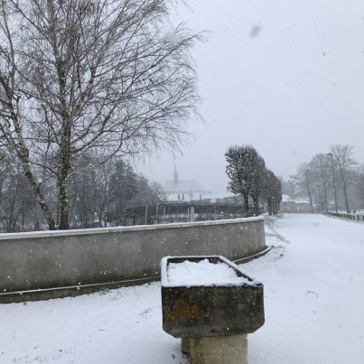 Snow - the church of Chablis in the background