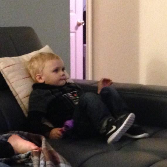 An NFL fan watching the Super Bowl.