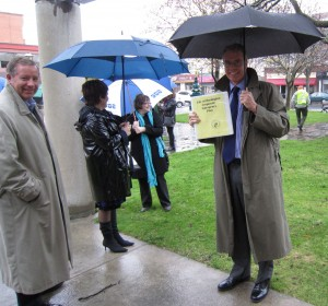 Mayor Goldring, out on the street in the rain with his staff while the fire alarm is checked.  The Mayor brought his emergency Measures Manual with him.