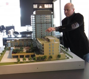Graham Chalmers, partner with Davies Smith Development points to a feature in the 16 storey condominium model that will break ground at the Appleby Line and Upper Middle Road location in Burlington