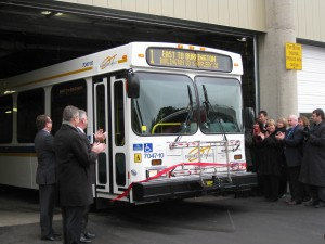 New bus cuts through a ribbon at the opening of the new Transit Operations Centre.  Lot of city hall talent on hand to cut a ribbon.  How much did it cost to have them all there to get their picture taken?  Did they take the bus or did they drive individual cars?