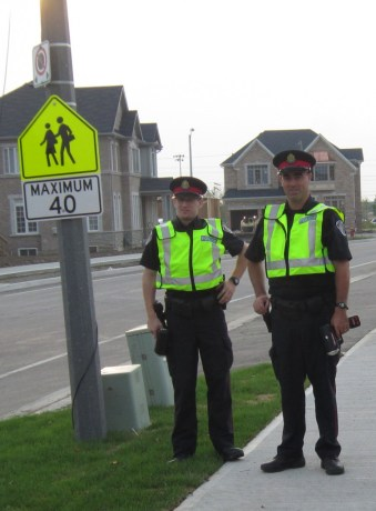 Speed limit sign is clear - so are those radar gunds in the hands of two police officers waiting for someone to break that speed limit. It was an All Hands on Deck day in Burlington earlier this week as police were out in force making the point that driving carelesly in school zones was not going to be tolerated.