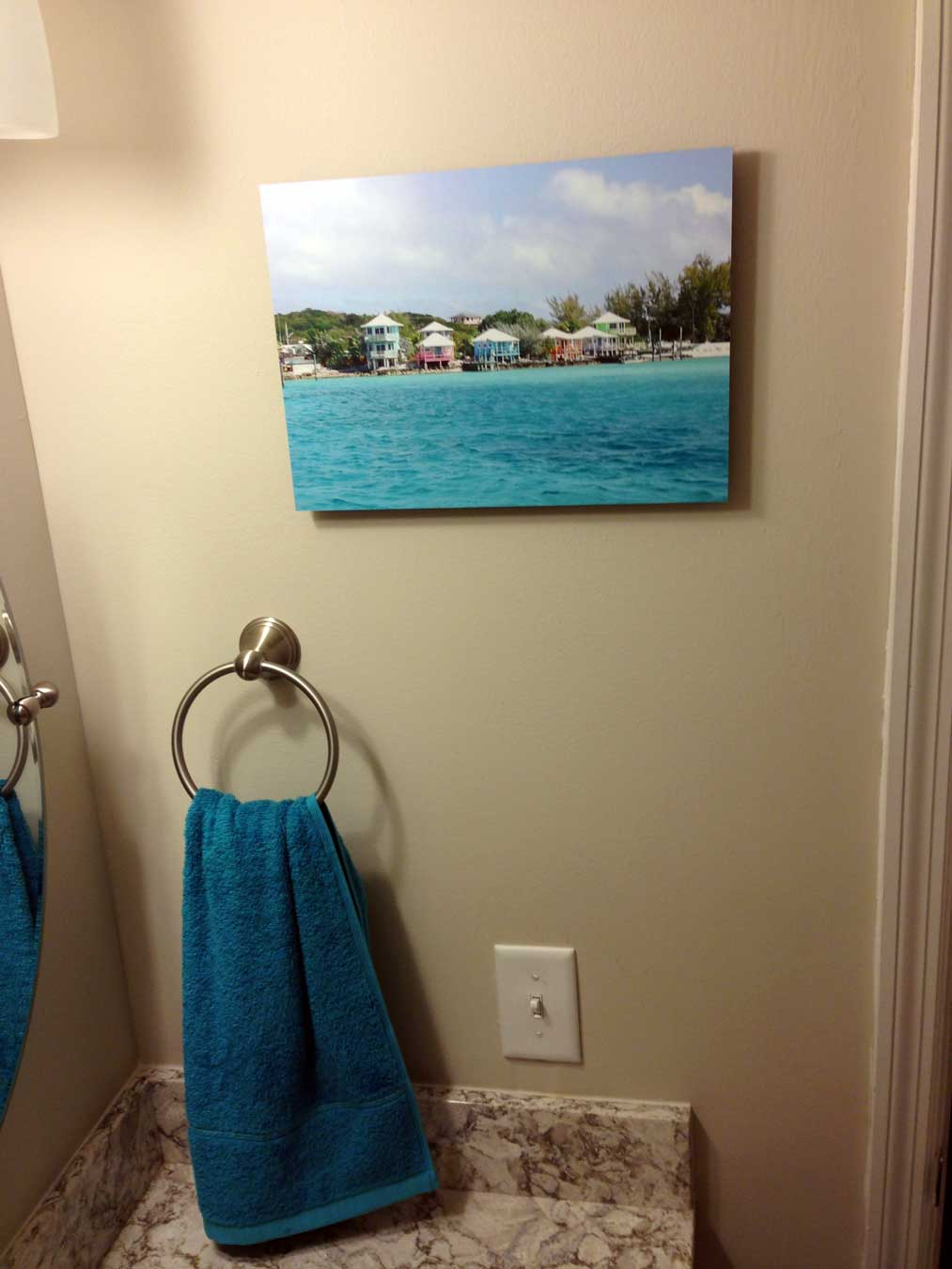 Aqua hand towel and a pic of Staniel Cay: Bahamas in the bathroom