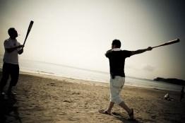 Family bosses practising baseball on the beach - 2009